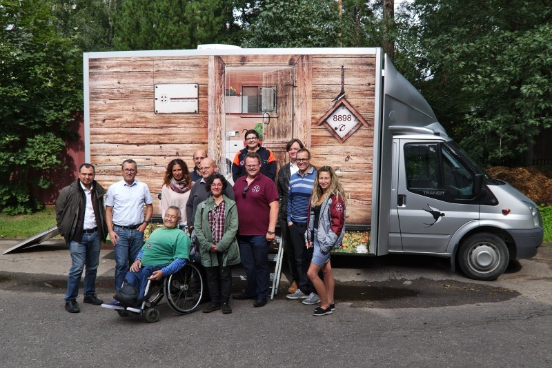 The project group pose for a group picture in front of a vehicle of the Mobile Care Complex, the Latvian Samaritan's outpatient care service for rural areas.