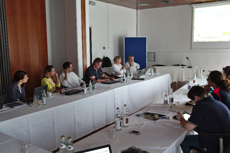 The project consortium and stakeholders in the meeting room.