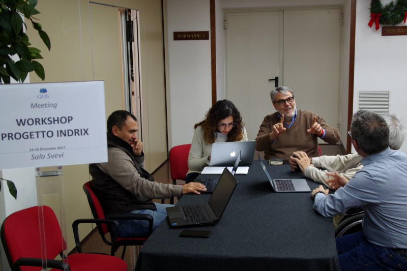 Several participants of the workshop discuss during a group work phase of the meeting.